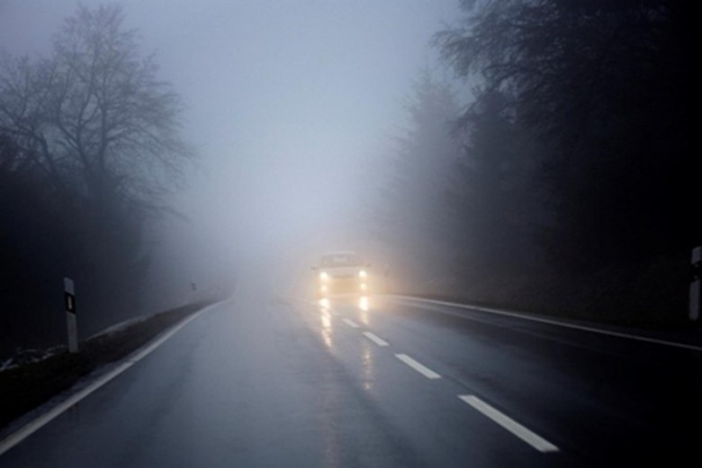 Fog on the country road, oncoming traffic