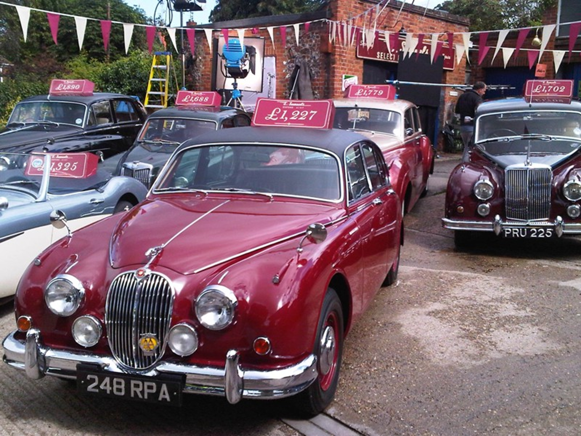The famous burgundy red Mk II Jaguar