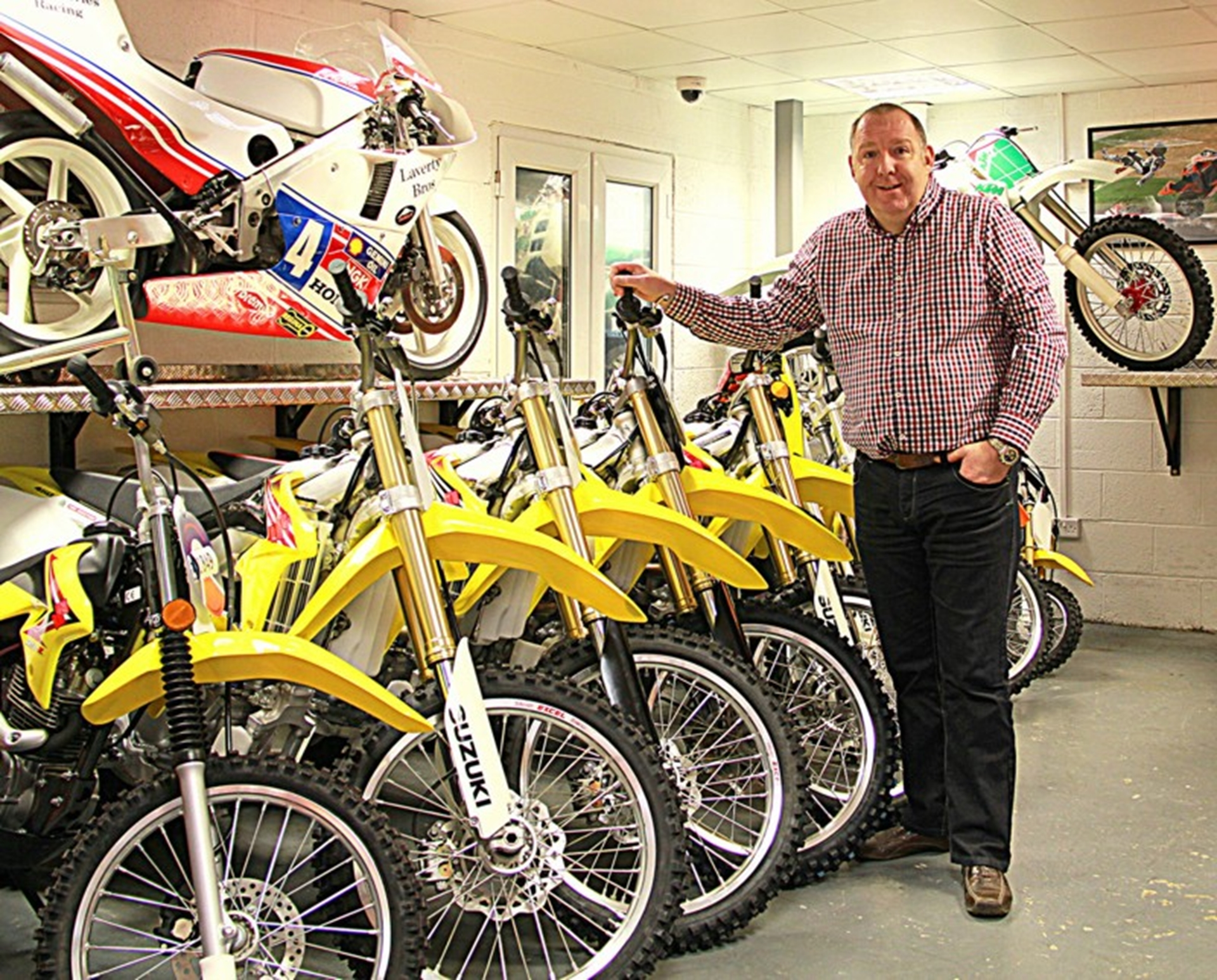 Tim Walker of Redline with the firms first batch of Suzukis