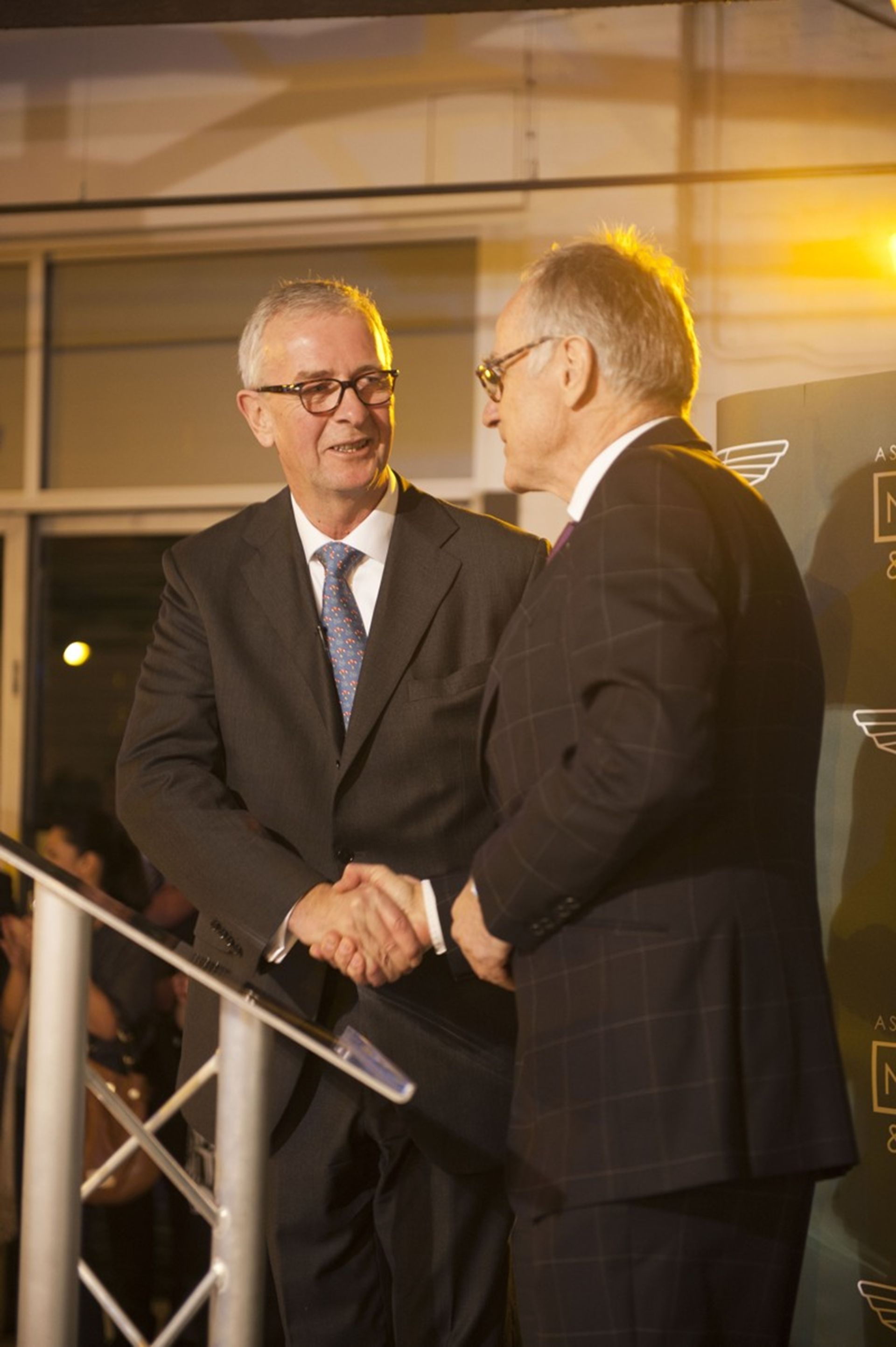 Nicholas Mee (left) shakes hands with Dr. Ulrich Bez