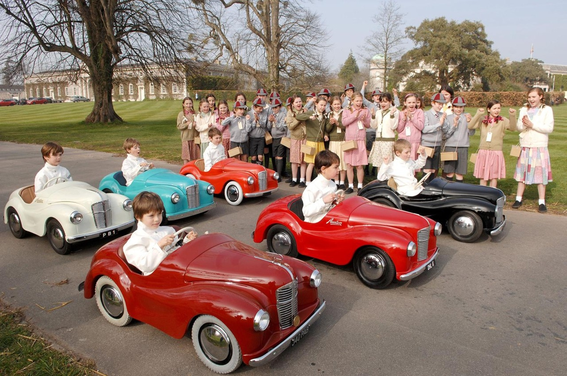 Austin J40 pedal car race at Goodwood Revival