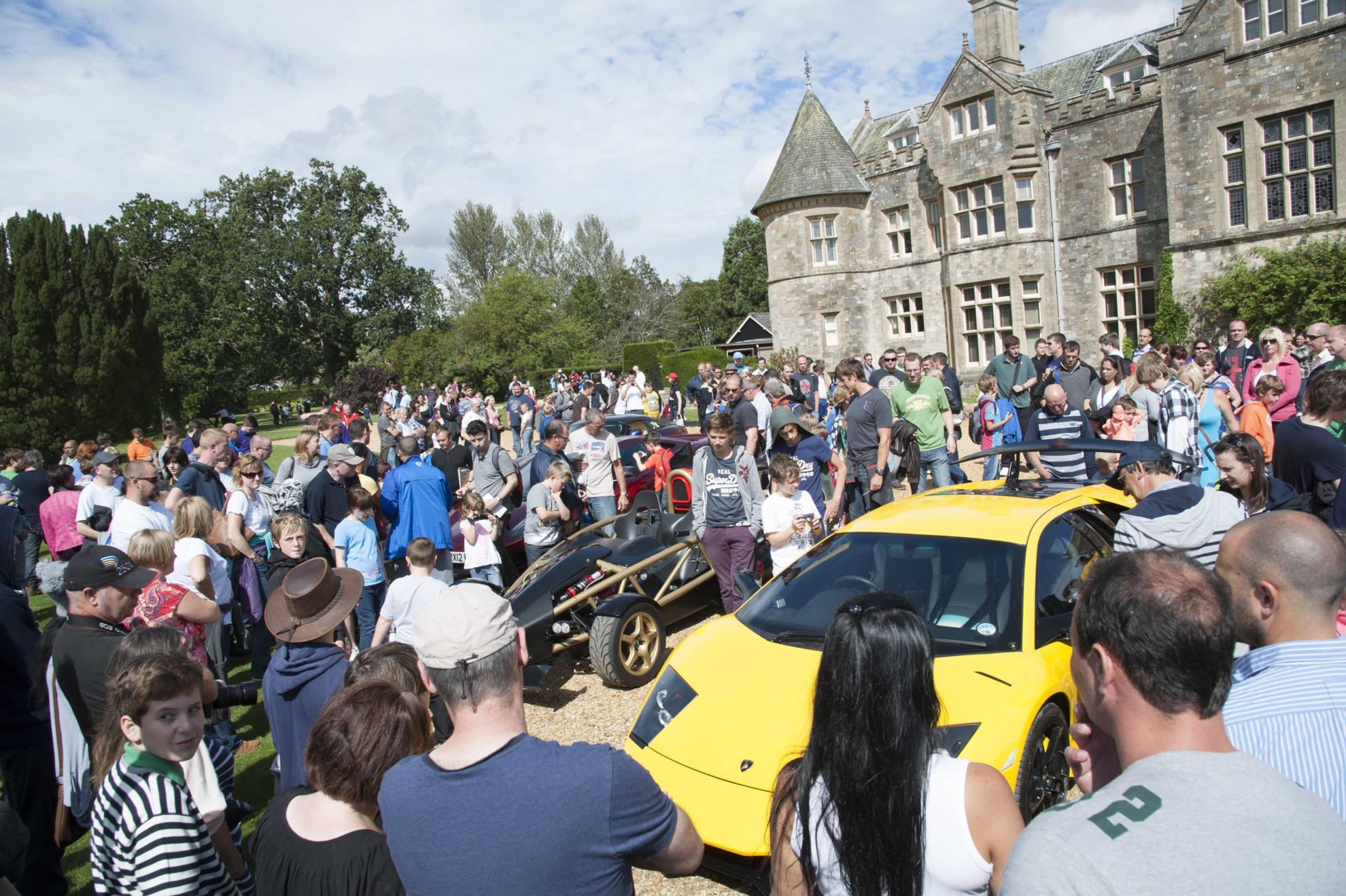 Crowds surround the supercar by Palace House