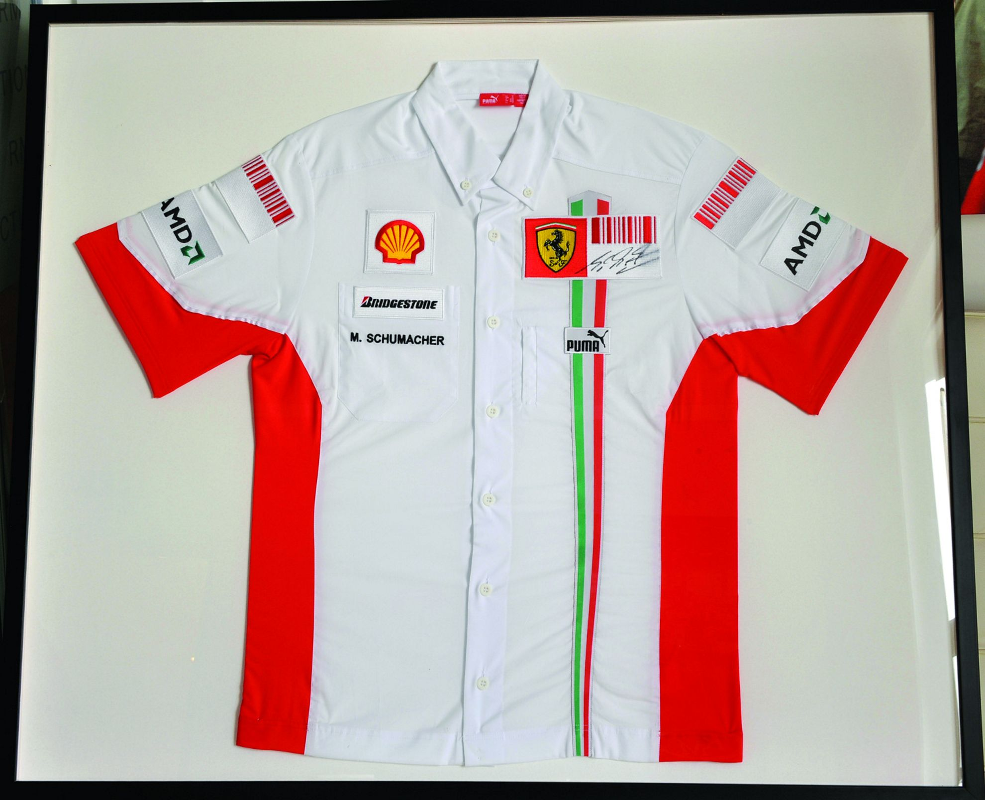 Ferrari_shirt_signed_by_Michael_Schumacher